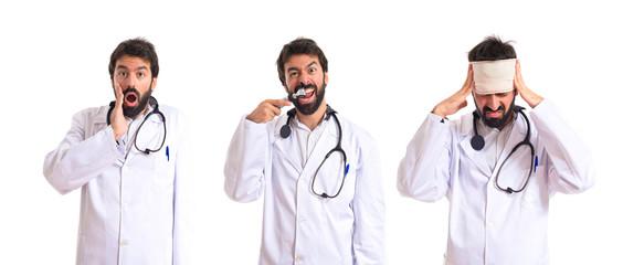 Crazy otorhinolaryngologist with his otoscope over white backgro