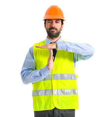 worker making time out gesture