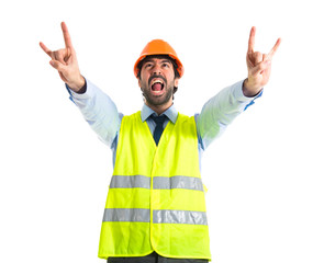 Workman making horn gesture