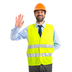 Worker saluting over white background
