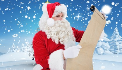 Composite image of santa checking list