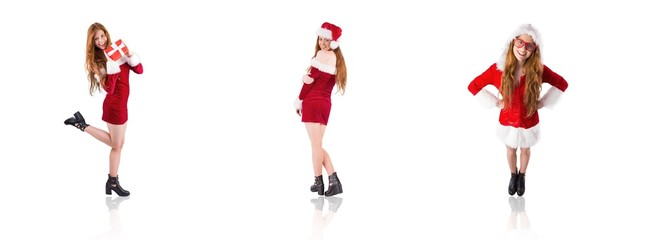 Composite image of festive redhead holding a gift