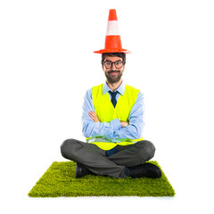 Workman with traffic cone like hat