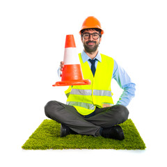 Workman holding a traffic cone