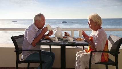Senior couple have breakfast at the hotel outdoor