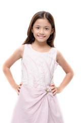 Little girl portrait on pink dress smiling on white background
