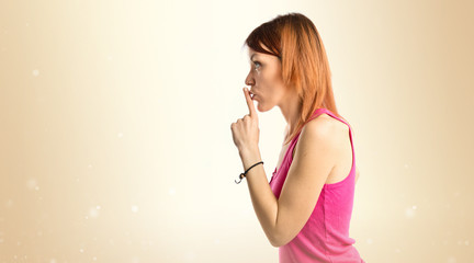 Young girl doing silence gesture