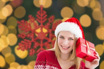 Composite image of woman checking her present