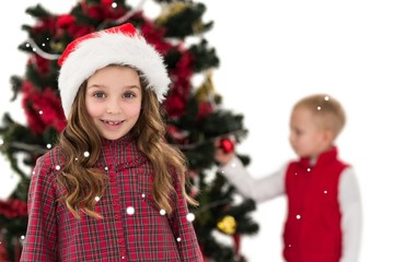 Festive little girl smiling at camera with boy behind