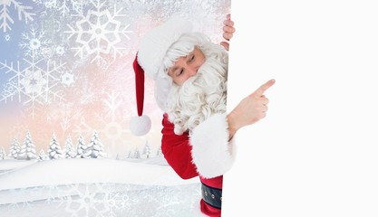 Composite image of festive father christmas presenting sign