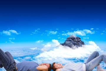 Composite image of couple lying on the floor