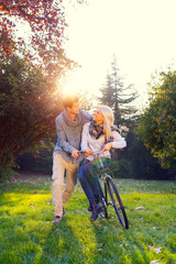 man and woman on a bicycle