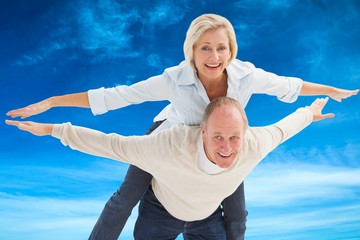 Composite image of happy mature couple having fun