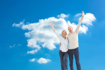 Composite image of happy mature couple cheering at camera