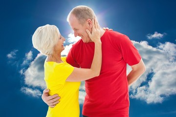 Composite image of happy mature couple hugging and smiling