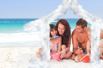 Composite image of portrait of a family at the beach