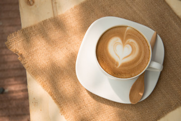 A cup of cafe latte with heart shape