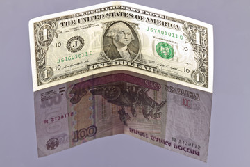 exchange rate of the dollar exceeded a hundred rubles