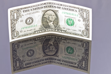 Banknote one dollar with your own reflection