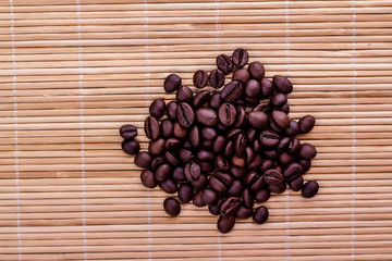 pile of coffee beans on wooden background