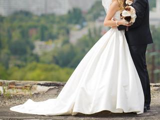 Embracing Newlyweds on Roof