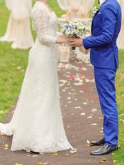 Holding Wedding Bouquet