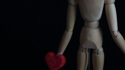 red heart in mannequin's hands
