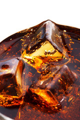 glass of cold cola with ice cubes