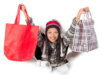happy woman holding shopping bags in a hole