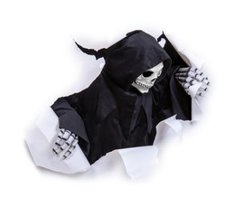 Grim reaper looking through hole torn in white paper