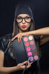 women makeup artist with palette and brush, eye shadows