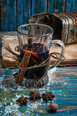 glass of mulled wine with spices in retro style
