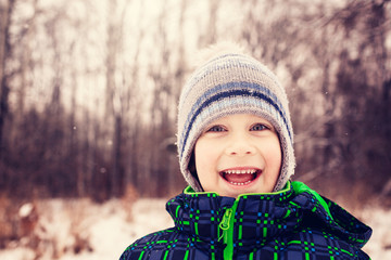 Portrait of smiling boy outdoors in winter