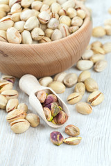 pistachios on wooden surface