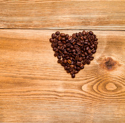 heart with coffee beans on a wooden table
