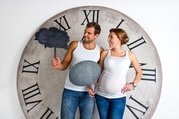 Happy Pregnant Couple showing sign speech bubble banners