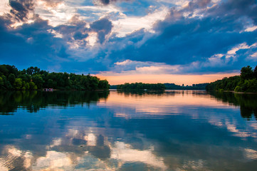 Reflection of trees and clouds at sunset in Lake Marburg, Codoru