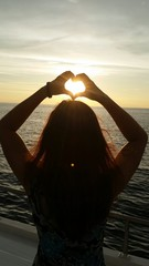 Silhouette heart at the sea