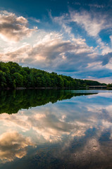 Reflections of clouds and trees at sunset in Lake Marburg, Codor