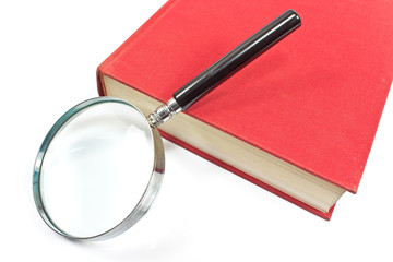 Antique magnifying glass on red book