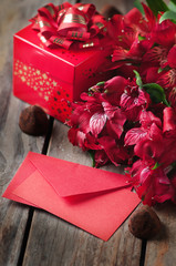box of chocolate truffles with red flowers