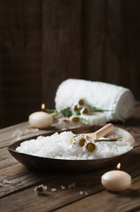 Spa concept with daisy, white salt and candles