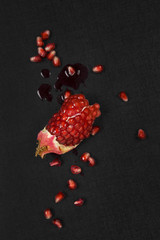Pomegranate on black background.