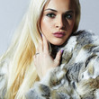Beautiful blond woman in fur.winter fashion.Beauty Model Girl