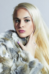 Beautiful blond woman in fur.Beauty Model Girl in Rabbit Fur