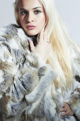 Beautiful woman in fur.Beauty blond Model Girl in Fur Coat