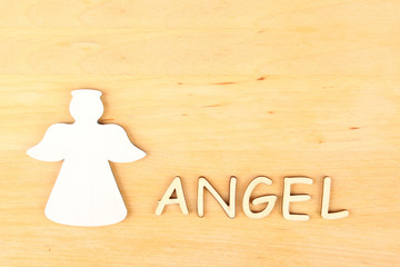 Angel silhouette and text