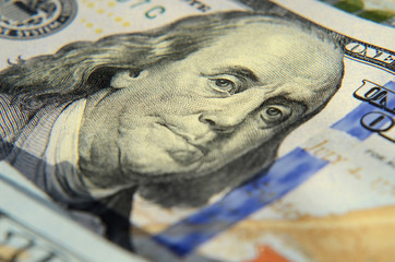 Image of Franklin on one hundred dollar banknote close up with t