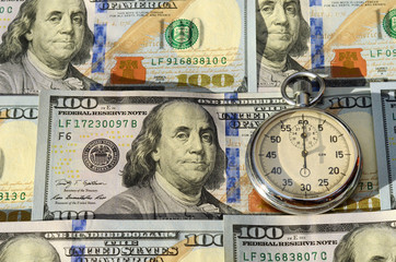 Stopwatch and dollars (time is money, capital, savings, profit -