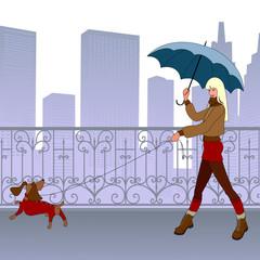 Girl walks with small dog